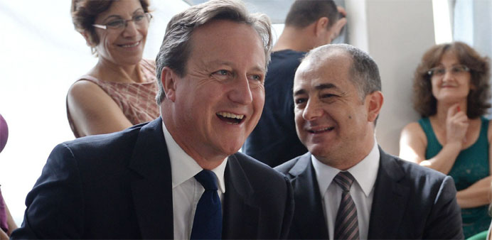 Britain's Prime Minister David Cameron (L) and Lebanese Education Minister Elias Bou Saab