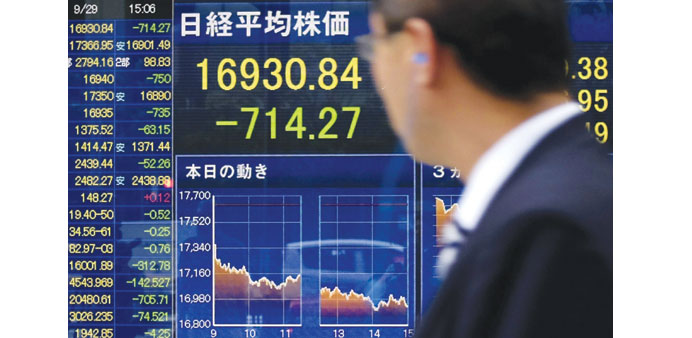 A man looks at a share prices board in Tokyo. Japanese stocks closed down 4.05% yesterday.