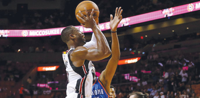Wade's last-second free throws lift Heat over Thunder