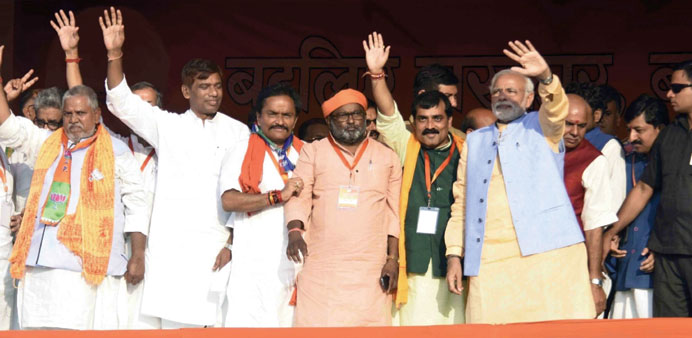 Prime Minister Narendra Modi waves to supporters during a rally in Darbhanga in Bihar yesterday.