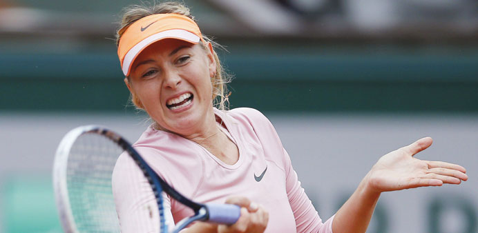 Sharapova to return to tennis in April after ban