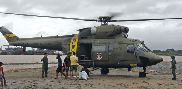 Members of the Philippine Air Force distribute relief goods to the residents after their town was ba