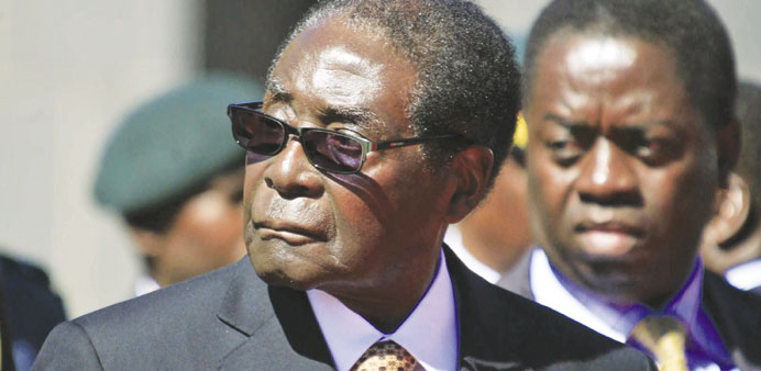 Mugabe tells S Africa media: I don't want to see a white man