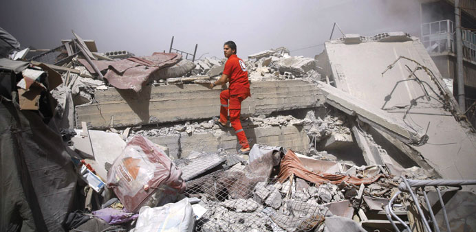 A member of the Syrian Red Crescent searches for victims in the rebel-held area of Douma, east of Da