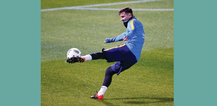 Barcelona player Lionel Messi attends a training session.