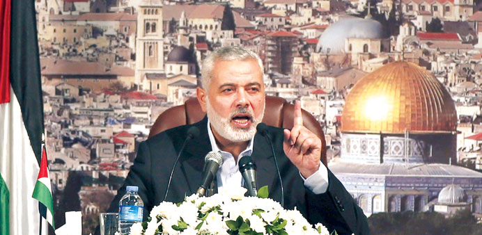 Hamas leader Ismail Haniya gestures as he delivers a speech in Gaza City yesterday.