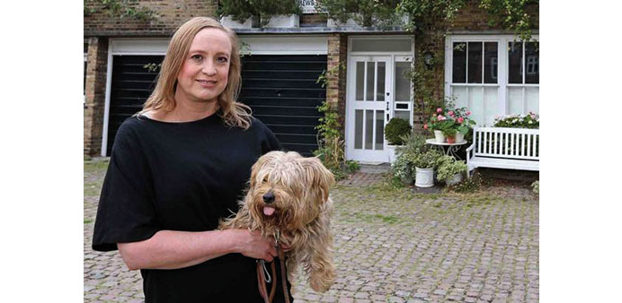 Divorce battle wife 'will not leave home'