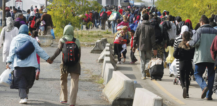 Migrants walk towards the Austrian border from Hegyeshalom, Hungary.