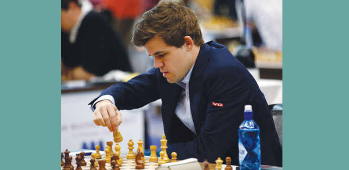 Giri held by Chao, top seed Carlsen back in joint lead