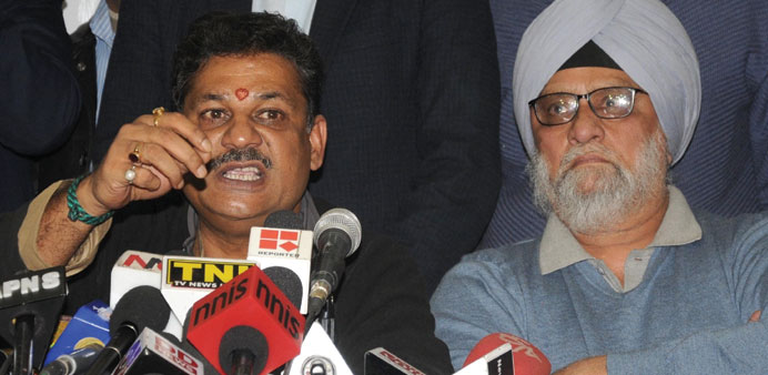 BJP MP and former cricketer Kirti Azad addresses a press conference in New Delhi yesterday.