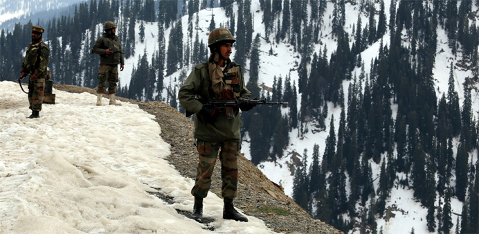 Indian army soldiers stand guard near to where an encounter took place in the Tanghdar sector north