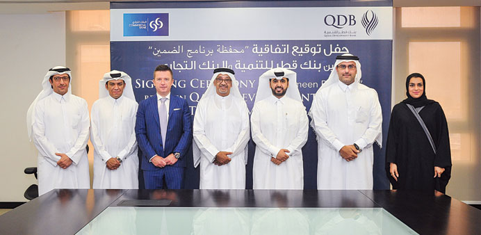 Commercial Bank, QDB sign deal to support SMEs