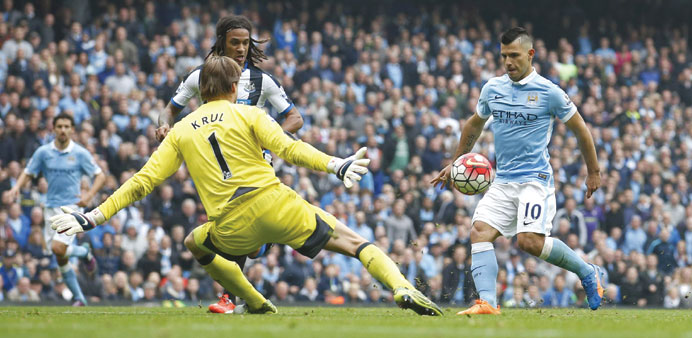 Manchester City's Sergio Aguero scores the third of his five goals against Newcastle. (Reuters)