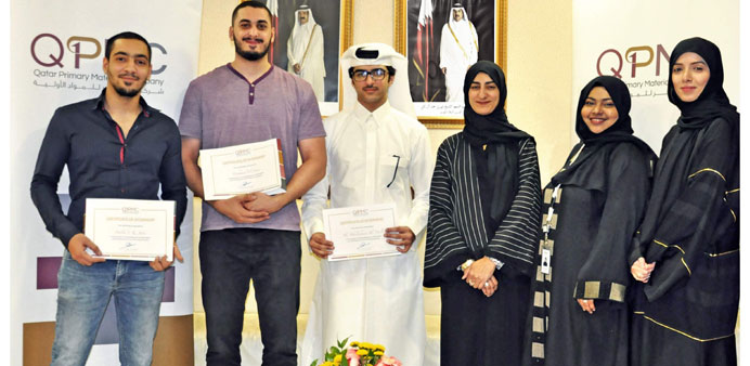 QU interns with QPMC officials.