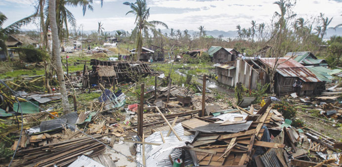 A general shot of houses destroyed by typhoon Koppu in Casiguran town, Aurora province northeast of