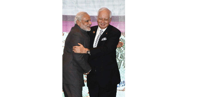 Prime Minister Narendra Modi and his Malaysian counterpart Najib Razak embrace as they take part in