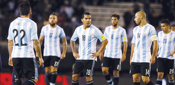 Argentina's players react at the end of their 2018 World Cup qualifying match against Ecuador at the