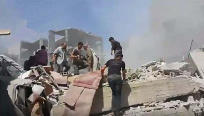 People search among the ruins of building after the air strikes