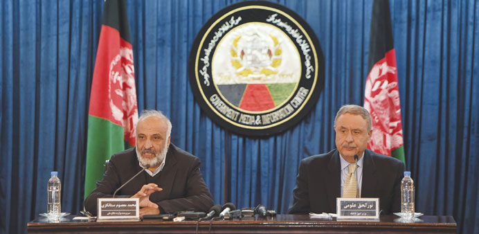 Afghan acting Defence Minister Masoom Stanekzai (left) speaks during a joint press conference with A
