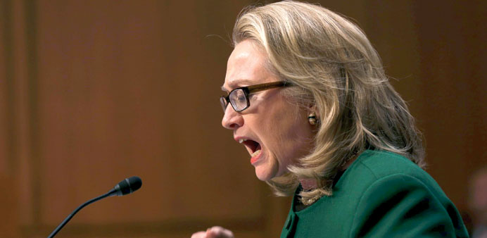 Clinton angrily denies charges of cover-up over Benghazi attack