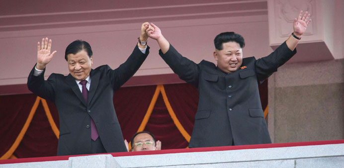 North Korea's leader Kim Jong-Un and Chinese Politburo standing committee member Liu Yunshan (left)