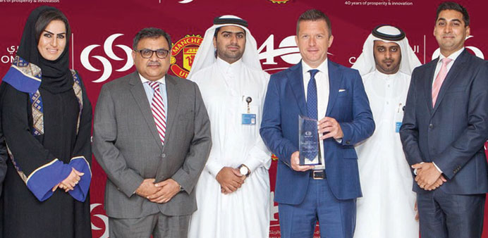 Commercial Bank officials with the innovation award from MasterCard.
