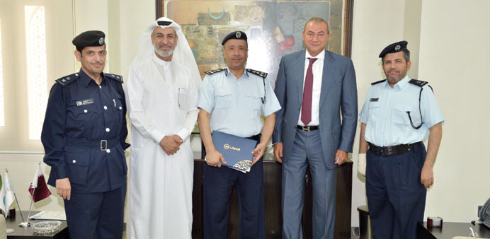 QIB and Traffic Department officials during the ceremony.