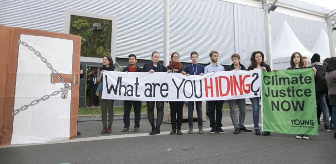 Members of Young Friends of the Earth Europe demonstrate during the World Climate Change Conference