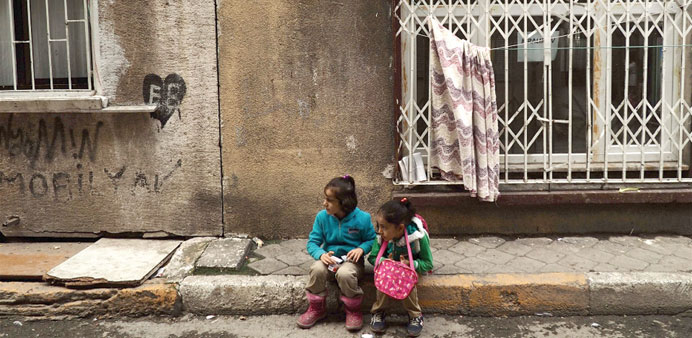 Two Syrian children in Tarlabasi neighbourhood, where poor and marginalised Syrian families live tog