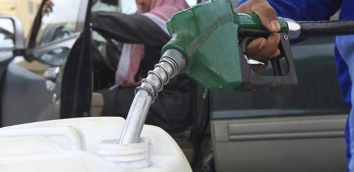 A container is being filled with diesel at a gas station in Riyadh in this file picture.