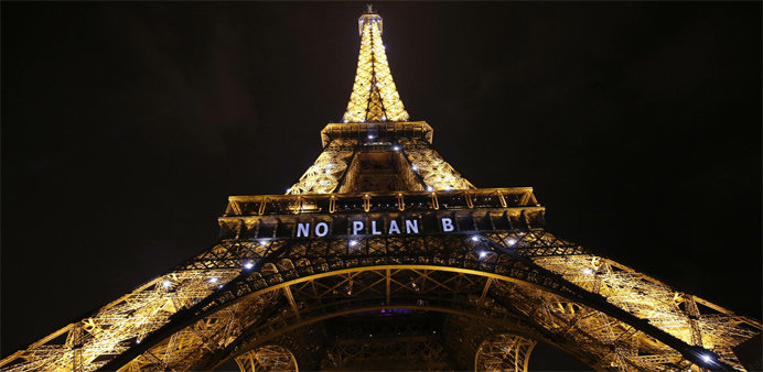 On brink of climate deal, nations set turning point from fossil fuels