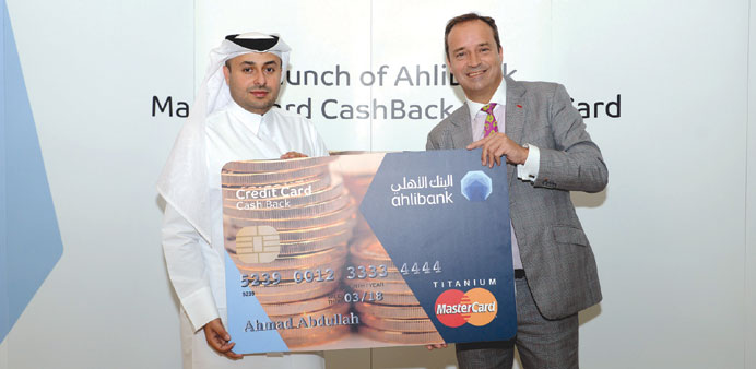 Ahlibank's Hassan al-Frangi and Andrew McKechnie with the MasterCard CashBack credit card.