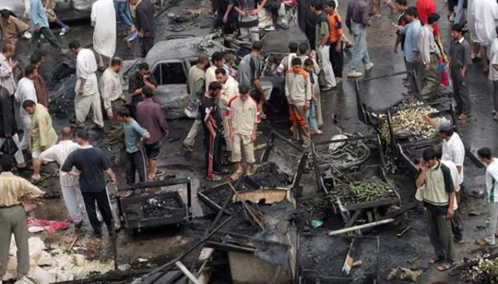 The scene after one of the blasts in Kadhimiyah