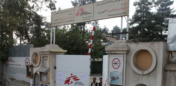 Afghan guards stand at the gate of Medecins Sans Frontieres (MSF) hospital