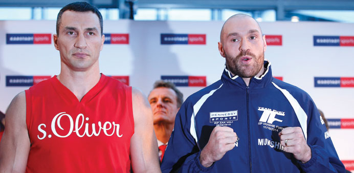 Wladimir Klitschko and Tyson Fury (R) pose during the weigh-in yesterday. (Reuters)
