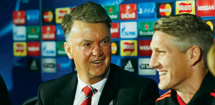Manchester United's Bastian Schweinsteiger and manager Louis van Gaal during the press conference.