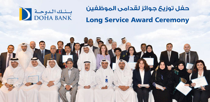 """Doha Bank officials and recipients of the """"Long-Service Awards"""" during the awarding ceremony."""