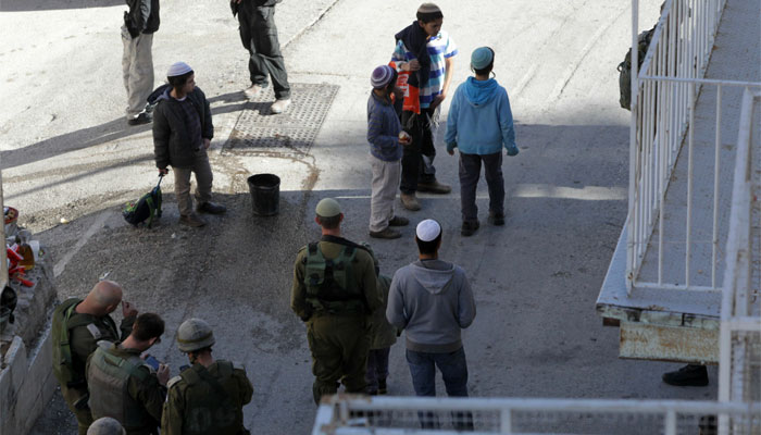 Four Israelis wounded in two West Bank attacks