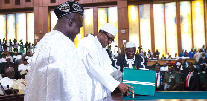 President Muhammadu Buhari lays a copy of the 2016 Nigeria budget on the table at the National Assem