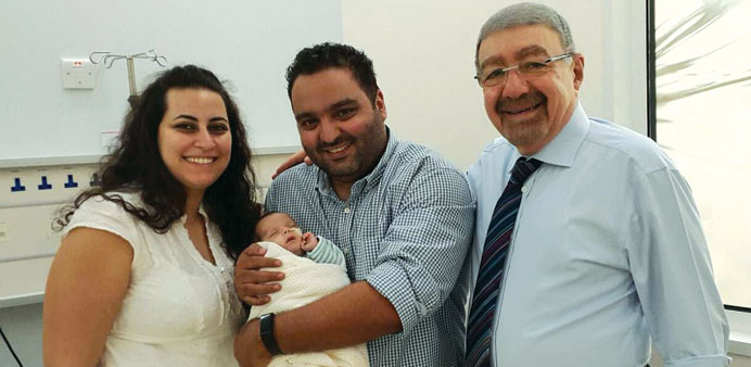 Dr Hilal al-Rifai with the parents and the baby who underwent the surgery.