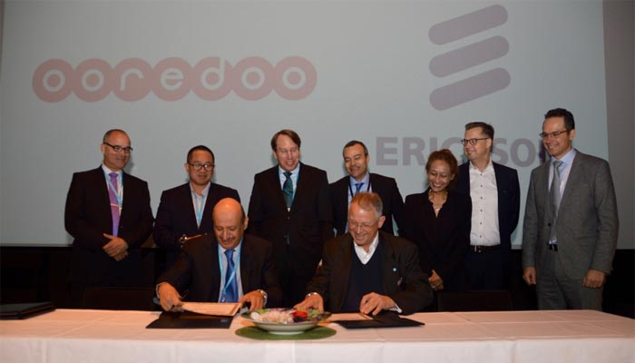 Ooredoo and Ericsson officials at the signing ceremony.
