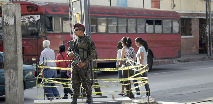 A soldier stands guard near a polling station in Guatemala City.