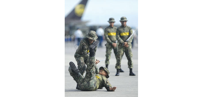 Soldiers show off their CQC (close quarter combat) skills during the Armed Forces of the Philippines