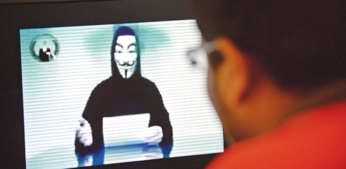 A person claiming to speak for activist hacker group Anonymous is seen issuing a warning through a v