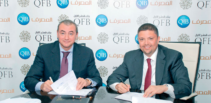Gamal with Emad concluding the QR365mn Murabaha facility.