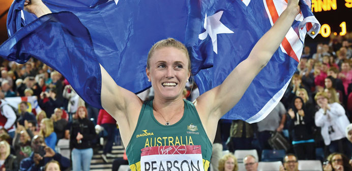 Australia's Sally Pearson celebrates after winning gold in the women's 100m hurdles athletics in Gla