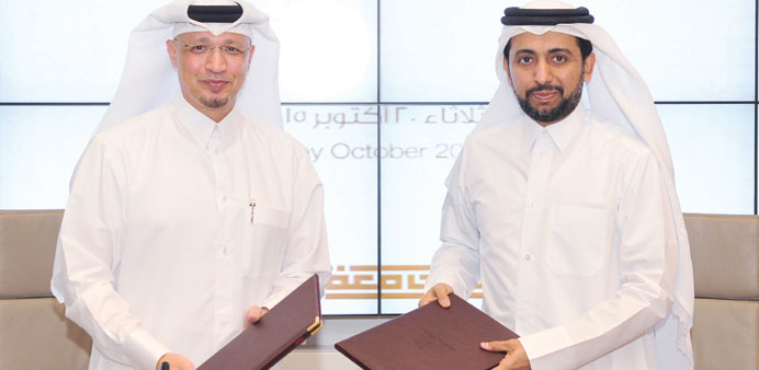 Al-Sayed and Dr al-Derham at the deal signing ceremony yesterday.