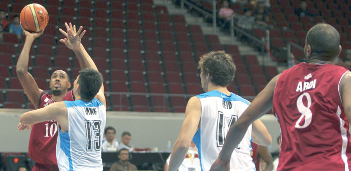 Qatar's top-scorer Jarvis Hayes goes for a three pointer in the Group B tie against Hong Kong in Man