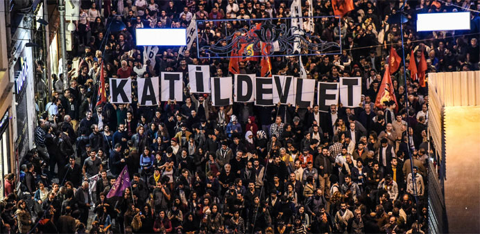 Thousands of protesters take part in a march against the deadly attack earlier in Ankara