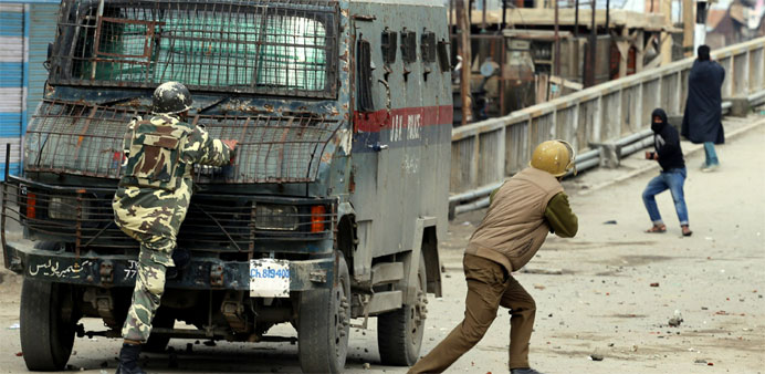 Indian police clash with Kashmiri protestors during a protest in Baramullah, north of Srinagar